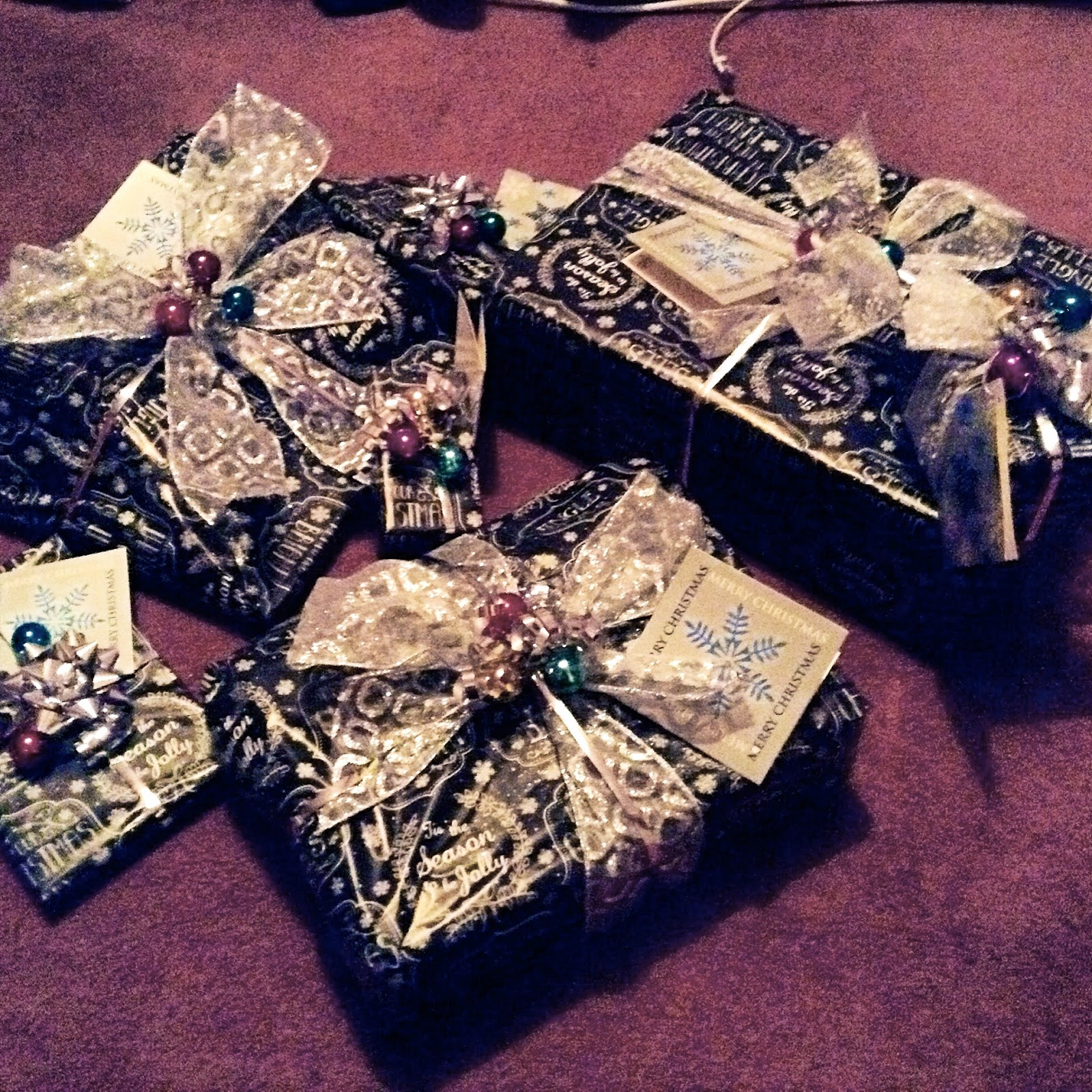 Presents wrapped in black & white paper with silver ribbon & baubles