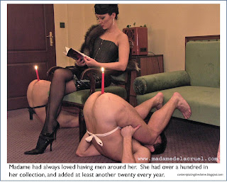 Dominatrix enjoys a good read as the wax slowly drips down the candles