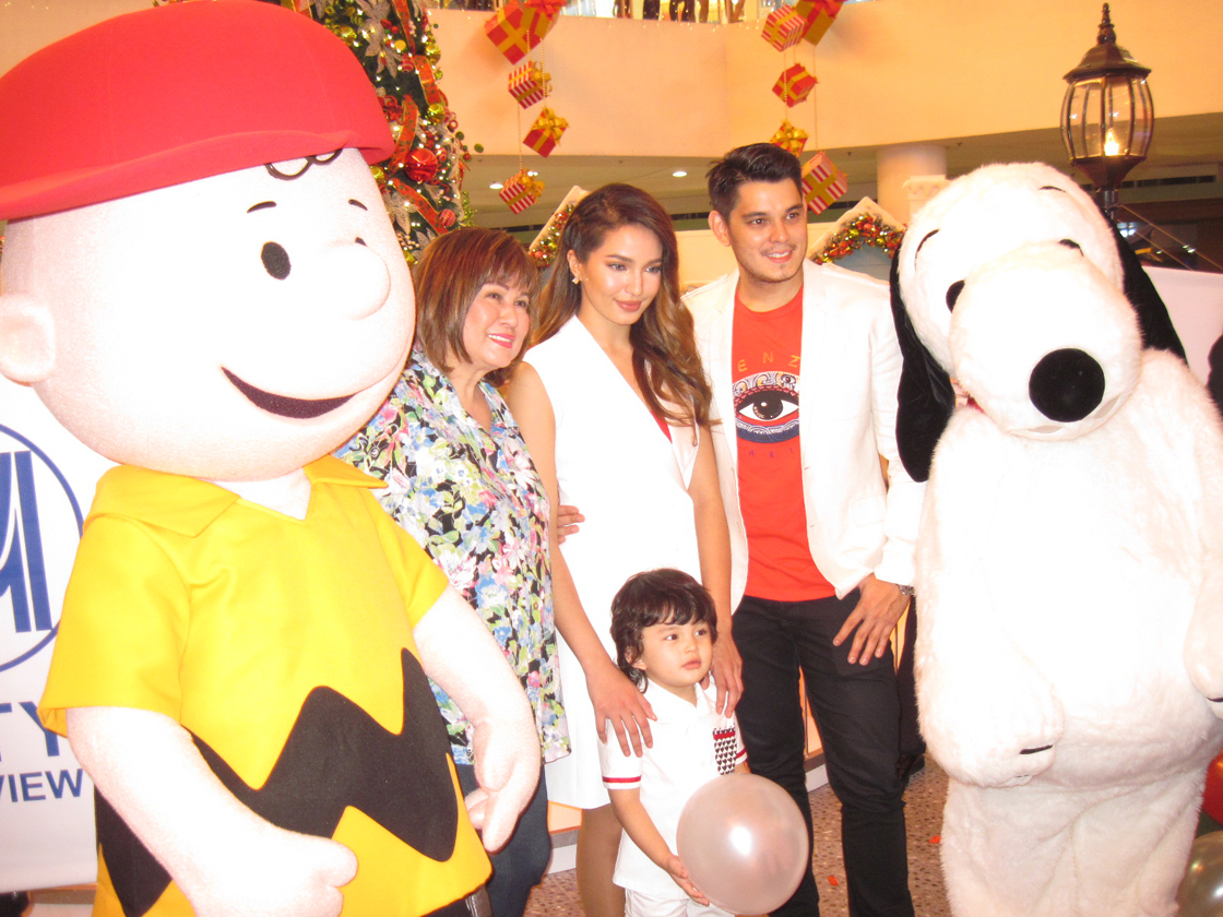 Gutierrez family with Snoopy and Charlie Brown at SM Fairview