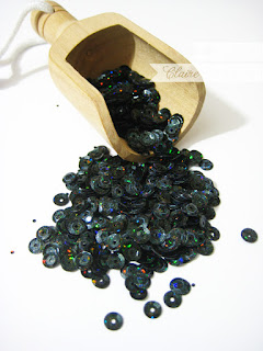 http://www.waltzingmousestamps.com/collections/new/products/black-holographic-sequins#content
