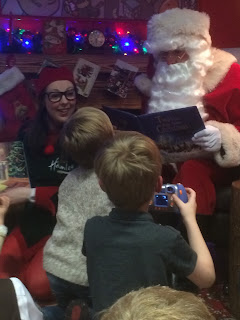 Children meet Santa Claus Father Christmas