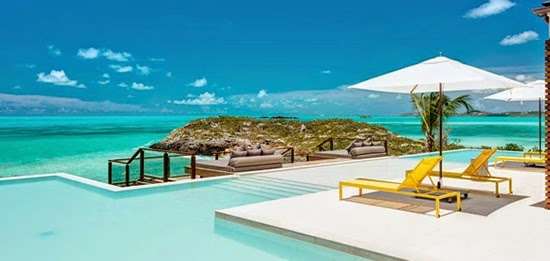 The pool and view from this magnificent property in Providenciales