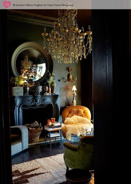 elegant neoclassic living room with black walls antique fireplace gold chandelier