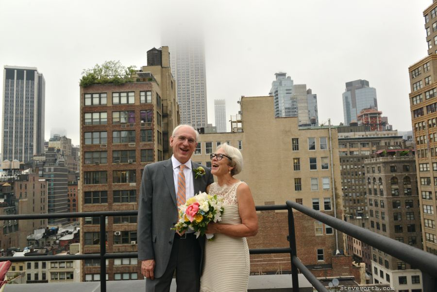 Rooftop portrait, NYC, with Empire State Building in Fog