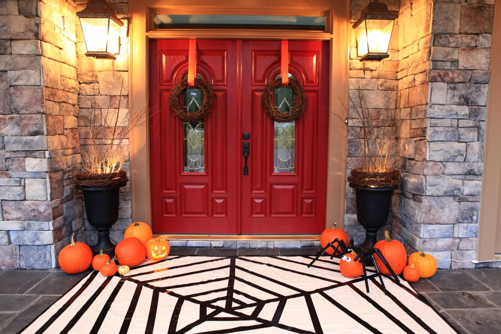 how creative is this tape spiderweb rug from our thrifty ideas looks pretty simple to pull off too and check out that cute spider pumpkin - Halloween Rug