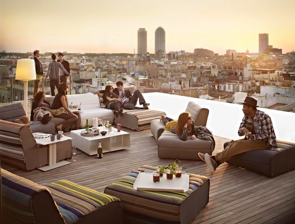 views at the skybar at the top of the grand hotel central between the centre of town and the port in barcelona relax with a cocktail u tapas from pm