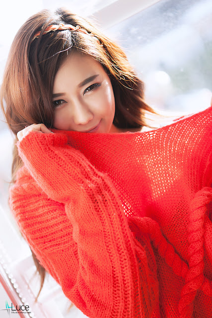 Kim Ha Yul in red sweater and white shorts