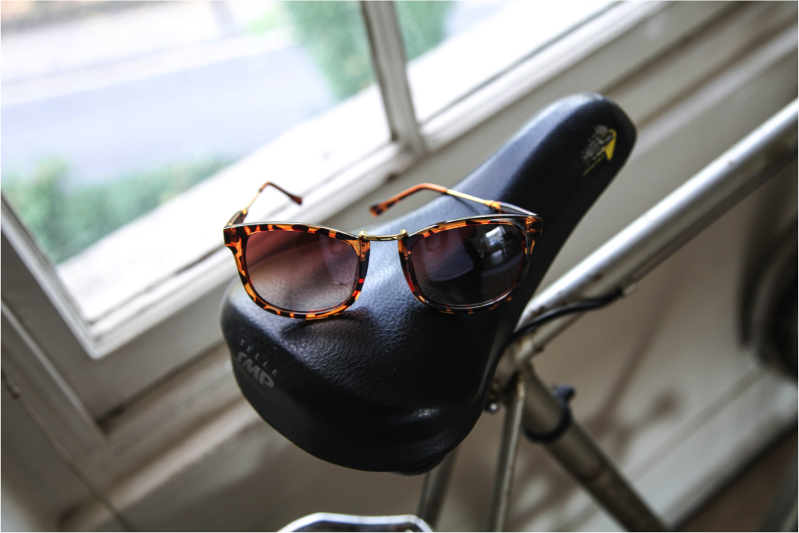 hipster fashion photography sunglasses on bike