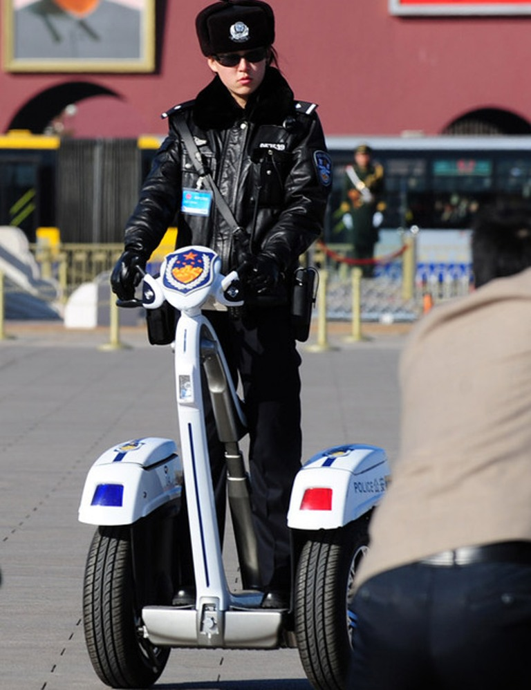 chinese female police officers patrol on segways