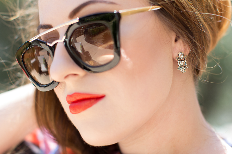 prada cat's eye sunglasses, rocksbox earrings, nars heatwave lipstick