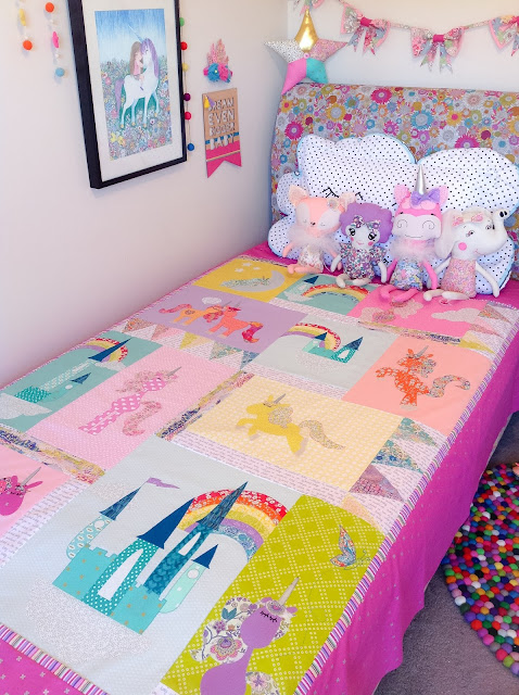 Closeup of Unicorn quilt on the bed