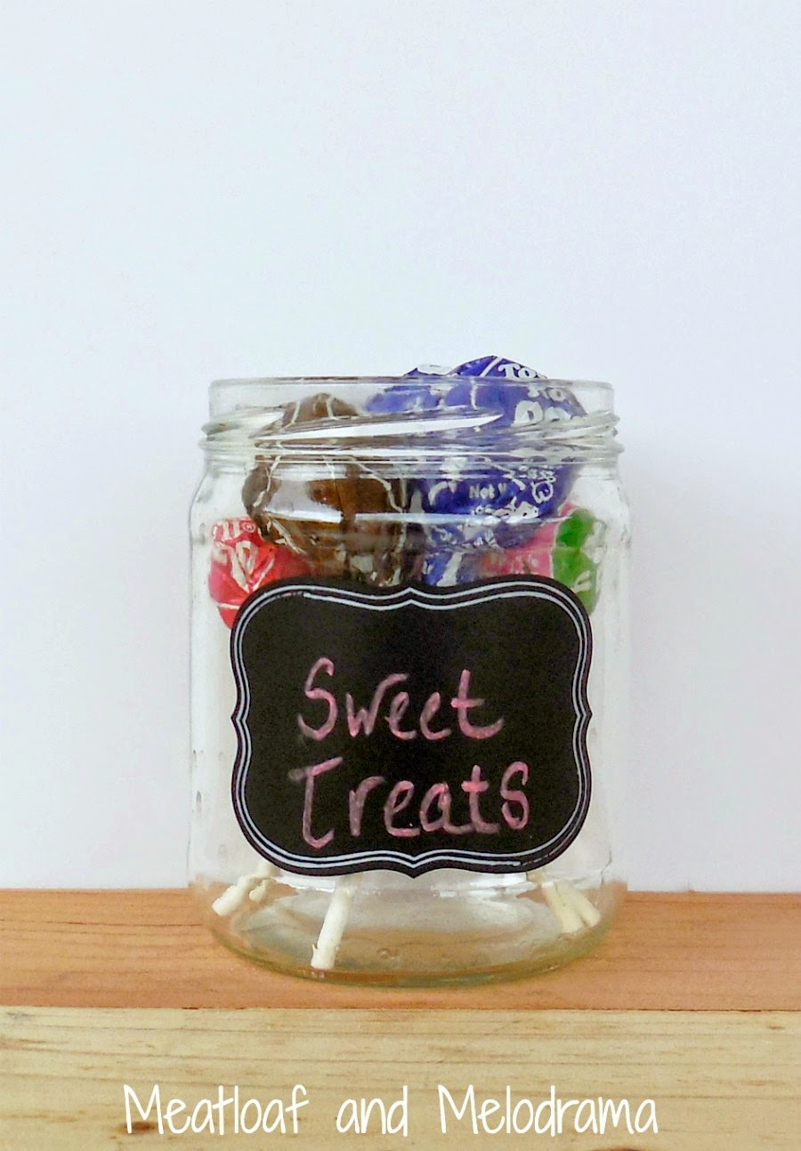upcycled glass jar with tootsie pops and chalkboard label