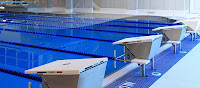 A picture from the local aquatic center's webpage, the lap pool with the starting blocks shown