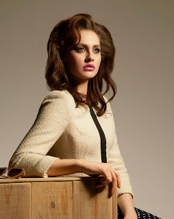 model in chanel style clothes with big vintage style hair and make up