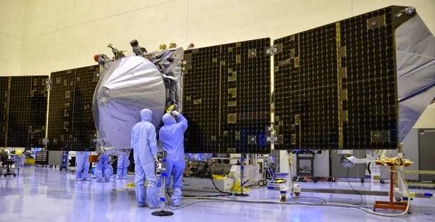 Techicians at Kennedy Space Center do final testing and preparations to the MAVEN spacecraft, designed to orbit Mars and make scientific measurements. MAVEN is scheduled to be launched between Nov. 18 and Dec. 7 on an Atlas V rocket. Credit: MALCOLM DENEMARK/FLORIDA TODAY