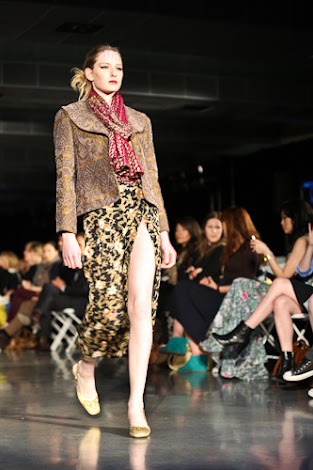 ecofashion week value village thrift chic show, posing in vintage, thrift chic fall looks, thick green jacket with floral slit skirt