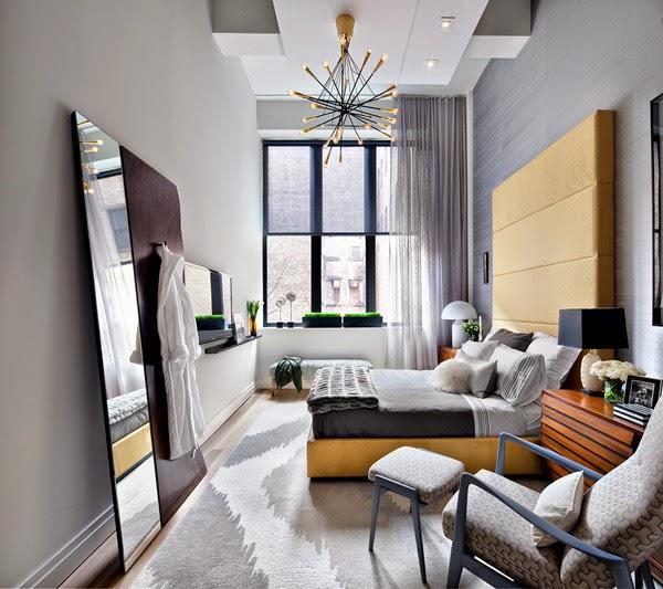 Un apartamento de doble altura en gris y amarillo a grey for Hauteur plafond chambre