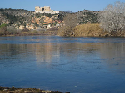 Miravet Castle reflected in Ebre river