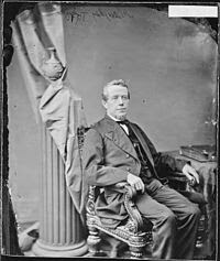 Portrait of U.S. Rep. Thomas Haughey sitting in a chair.