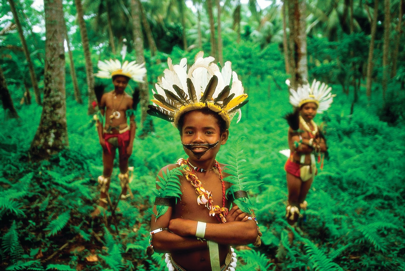 Young Trobriand Island boys from Kiriwina Island in traditional bilas - Papua New Guinea