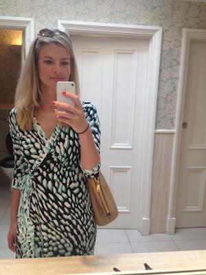 fashion blogger, green wrap dress, prada, prada bag, beige bag, selfie, essie nail varnish, essie