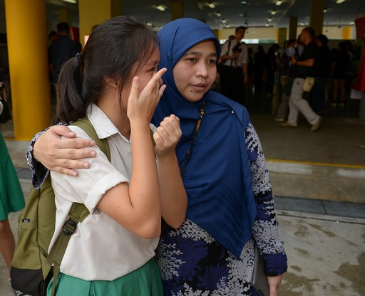 Justine Lai, 16 from Tanjong Katong Secondary School seen crying.