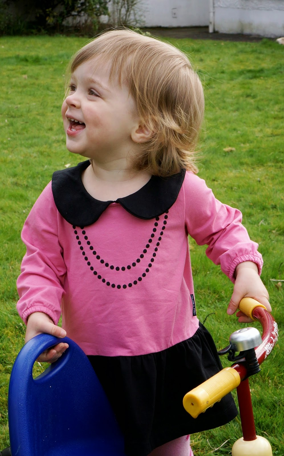 smiling toddler polarn o pyret dress with pearls