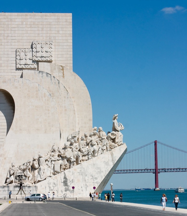 lisbon statue monument along coast