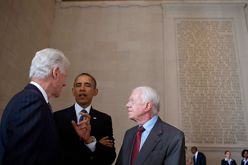 Carter (right) with U.S. President Barack Obama (center) and former president Bill Clinton (left) on August 28, 2013.