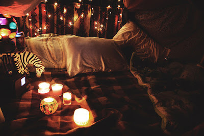 Blanket fort with candles