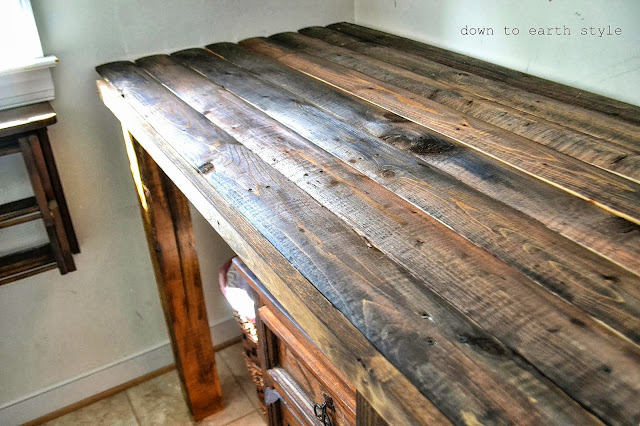 Reclaimed wood laundry room folding table by Down to Earth Style, featured on http://www.ilovethatjunk.com