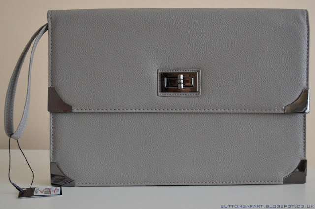 a picture of a grey clutch from primark