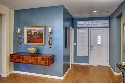 blue and white is like the canvass for artistic details in this entryway