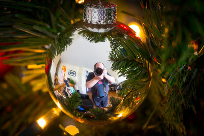 Scott takes a self-portrait in a reflective Christmas tree ornament.