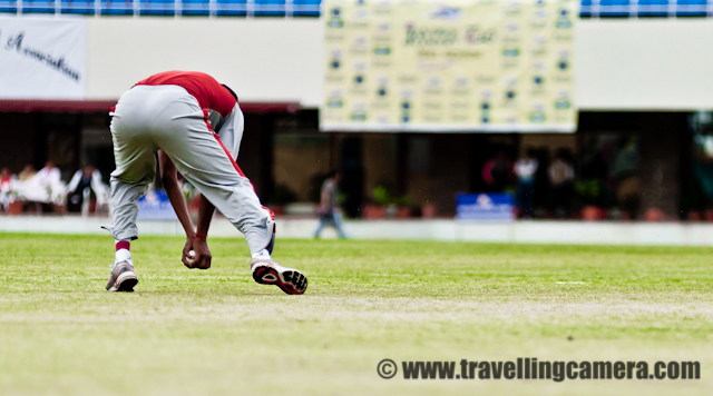 T20 Cricket Mahasangram - A Cricket Tournament that broke World Records : Postd by VJ SHARMA on www.travellingcamera.com : The Jaypee Twenty20 Mahasangram has made into the Guiness Book of World Records as the world's largest cricket tournaments. The statistics it boasts of are unbelievable. Consider the following: A total of 1,406 teams, 19,684 players, near about 2000 matches, 77 grounds on which 150 matches were played daily.I had never heard of anything like this before. And when I did hear about it, I could not resist attending the final match of the tournament. The match was also attended by Mr. Anurag Thakur, MP Lok Sabha who is also the President of Himachal Pradesh Cricket Association and a Member of the IPL Governing Coucil.This is the cricket stadium of Dharamshala situated height of 1,457 m above the sea level. With such beautiful backdrop, how do players manage to concentrate on the game? Even the stalls are so pretty. More matches should be played here. During this event, it came to know that 3 matches of upcoming IPL will be played in this beautiful Stadium...Here are the HPCA and Jaypee officials talking to media. A tournament of the size of Jaypee Twenty20 Mahasangram takes a lot of courage and co-ordination to organize. These men and their teams have been instrumental in taking the cricket scene in Himachal Pradesh to greater heights.Here is one of the finalists, the team from Mandi posing for a photograph with Mr.Anurag Thakur. I love their uniforms. I did not know red and grey could look so good together. The second finalist was the team from Una.Mandi team got to bowl first. Here is there wicket keeper grasping the ball.Here is a batsman from team Una walking back to the pavilion after being given out. Notice the dress again. Excellent combination. I think a few of the international teams can learn from the designers of these dresses.Another batsman going back to the pavilion. The excitement was increasing with each passing minute. This is the advantage of Twenty20. It is like a quick adrenaline rush. Each moment is so full of action and tension.The Umpire in the field and the HPCA and Jaypee officials sitting in the stall in the background.Superb bowling action. The wickets are black though. I don't think I have ever seen black wickets being used in cricket before this. But I may be wrong.HOWZZAAAT!! Well it's clearly out, No need to ask the third umpire for this one.And the ball is out of the bowler's hands. Whatis it going to be this time?Drinks break. I am fascinated by the colours used in the stall. Green, yellow, blue, pink so far. Very vibrant, very happy.Seems like good leg movements. At the far end, the other batsman is ready to make a run for it already. And the bowler is getting ready to stop the single.Kinley - I cannot imagine how many bottles would have been consumed during the tournament. Perhaps if they have kept a count, it can be another record broken in the Guiness Book.It is always good to pad up and to don the helmet. Just like riding a bike, cricket is a tricky business too.Very athletic. I am so glad I managed to catch this bowler in the air. He was always on a move.Looks like a fast bowler because of his height and a long run up.Another agile movement by a fielder of the Mandi team.Good fielding is as important as good bowling and good batting. It helps in restrict runs and batsmen. An agile fielding helps put pressure on the opponent team and leads them into doing foolish things.And here is oneof the men behind the official cameras. He covered most of the matches of this tournament.The view from the chief guest stall. All players seem so far away and then there are those magnificient mountains in the backgroud. A perfect view.It's now Mandi's turn to bat and here is a quick singles. Just like good fielding puts pressure on the batting team, quick singles put tremendous pressure on the fielding team. It's like psychological warfare.Running behind the ball to save the boundary. I have seen this situation in many international games but things are far more exciting in a Twenty20 match with fielders on their toes. Right now though, the batsmen of Team Mandi seem to be making them run all over the field.And its out. Team Una celebrating after one of Team Mandi's batsman is given out. HiFives, Hugs and jumping around makes the entire environment charged. Who can say that these are grown-up men?While the batsmen from Mandi were playing shots all over the field, the fielders from Una are leaving no stonesuntered and are throwing themleves on the ball.A bowler getting ready for a run up.Some of these fielders were so agile that I was wondering why they were not in the Indian Squad. And also the passion. It was amazing to see.Brightly coloured stands. Even if you look closely you cannot see the paint chipping from anywhere. Seems like everything was prepped up for this tournament and has been maintained really well. Kudos to the authority that maintains this stadium.Good leg movement there. And the ball is clearly visible against the green ground. Another achievement for the authority that maintains this ground. I would have loved to play on this. Though I am not much of a cricket player myself.Did he get it?A good attempt. These men seem to spend as much time in air as on the ground.Another good attempt. But this one made it for a four.Is this another catch?This is one active picture. The bowler just finishing his action, the batsman hitting the ball, the runner just starting his run between the wickets, and he empire standing around. All this happened in a matter if seconds. Hard to believe, isn't it? A good answer to people who say that cricket is a lazy sport.Is he going to get this? All three pairs of eyes are on the ball at this moment.And it is out. Love the tension. No wonder cricket is such a popular game in India. HPCA and Jaypee are doing a great job in making sure that young talent from HP gets enough exposure.The team from Mandi gave away their last few wickets in a quick succession resulting in the team from Una winning the tournament.It must mean so much to come on top amongst 1406 teams.And here is Mr. Anurag Thakur giving his final speech. His speech gave me answers that I was looking for. Why aren't more matches held in Dharamshala? because there aren't enough hotels and facilities that are up the the standard to host international guests. He mentioned about the huge amount of investments that are being made into promoting cricket in Himachal Pradesh and how one good stadium is already been buil. He also mentioned about the fact that whenever new stadiums will be planned they would also plan to upgrade the fascilities in the area. He mentioned about one five-star hotel being built in Dharamshala. He revealed that some (three) matches of IPL will be played in Dharamshala this time and requested people and fascilitators to co-operate so that in future, more such matches can be hosted here. This was a true sportsman speaking.I am happy to see that so  much of emphasis is being given to sports in Himachal Pradesh. If it is cricket now, it'll be some other sport later. But as long as we realize the importance of sports in our lives, we have really come several step ahead. Gone are the days when our elders would tell us