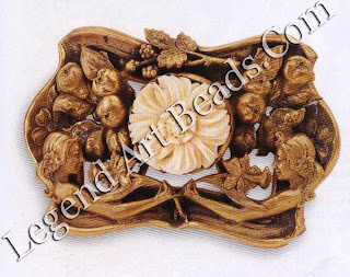 This belt buckle is of unknown manufacture but is most certainly French in origin. The tarnished gold finish (in stamped brass) is reminiscent of Russian-gold plating, giving it a Very antique feel. The design itself is archetypal of the period, with naturalistic, romanticized maidens, and floral and fruit motifs, and is applied with a crudely carved bone flower. c.19oo £12.0-150 ($205-255)
