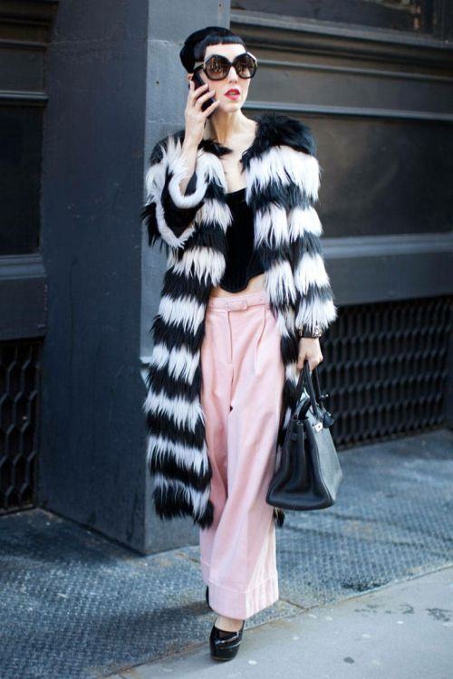street style form NYFW with glamorous black-and-white coat and pink pants