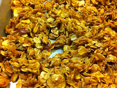 Almond granola on baking sheet