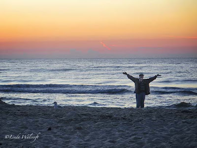 Man at dawn on beach