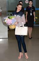 Miranda Kerr with a flower bouquet