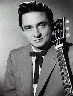 """transcendentalism and johnny cash Johnny cash, who was born on this day in 1932, once wrote, """"i love songs about horses, railroads, land, judgment day, family, hard times, whiskey, courtship, marriage, adultery, separation."""