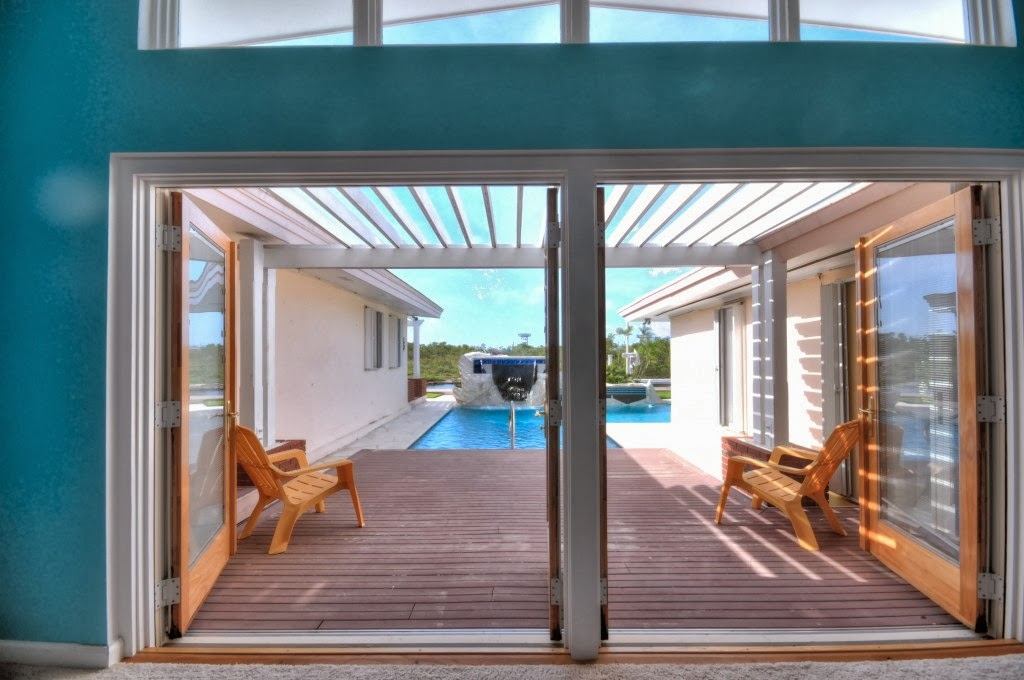 Come home to paradise featured luxury listing key west for Canal front home designs