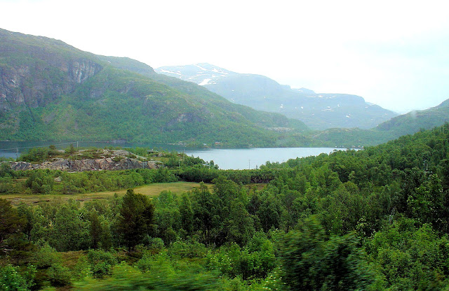 A panoramic view of Reinungvatnet mountain lake at the beginning of journey.