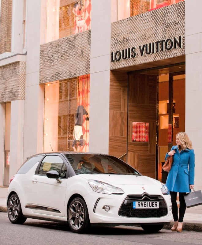 Citroen DS3 parked outside a Louis Vuitton shop