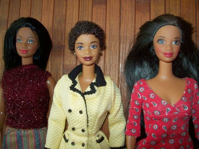 Three Nichelle-faced dolls: Halloween Fun, Avon Representative, 101 Dalmatianss