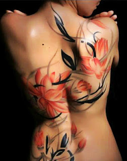 ink wash painting style lotus flower tattoo design on the back