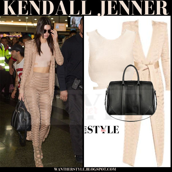 Kendall Jenner in beige matching balmain cardigan and leggings, crop top and black bag what she wore model style