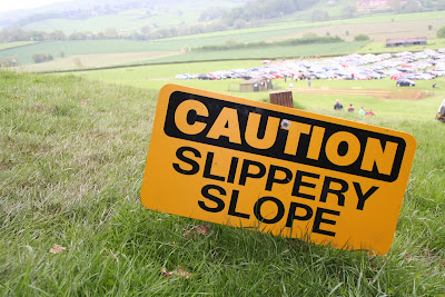 CAUTION SLIPPERY SLOPE