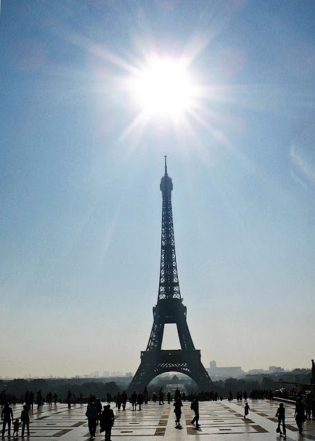 Eiffel Tower with bright sun above