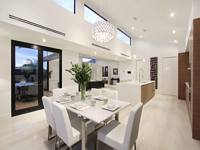 Picture of modern dining room by the kitchen with white chairs and modern table